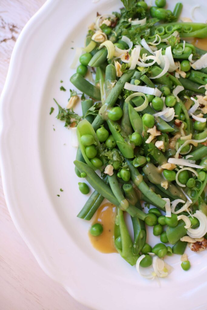 Crunchy Green Bean, Pea and Walnut Salad on a white platter