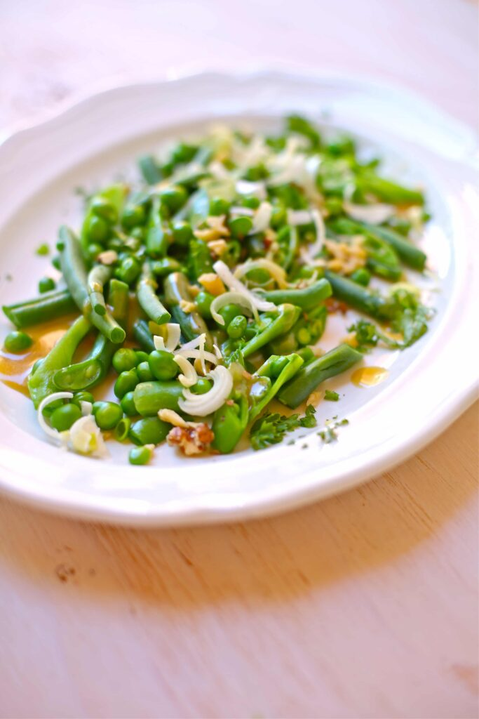 Crunchy Green Bean, Pea and Walnut Salad on a white plate
