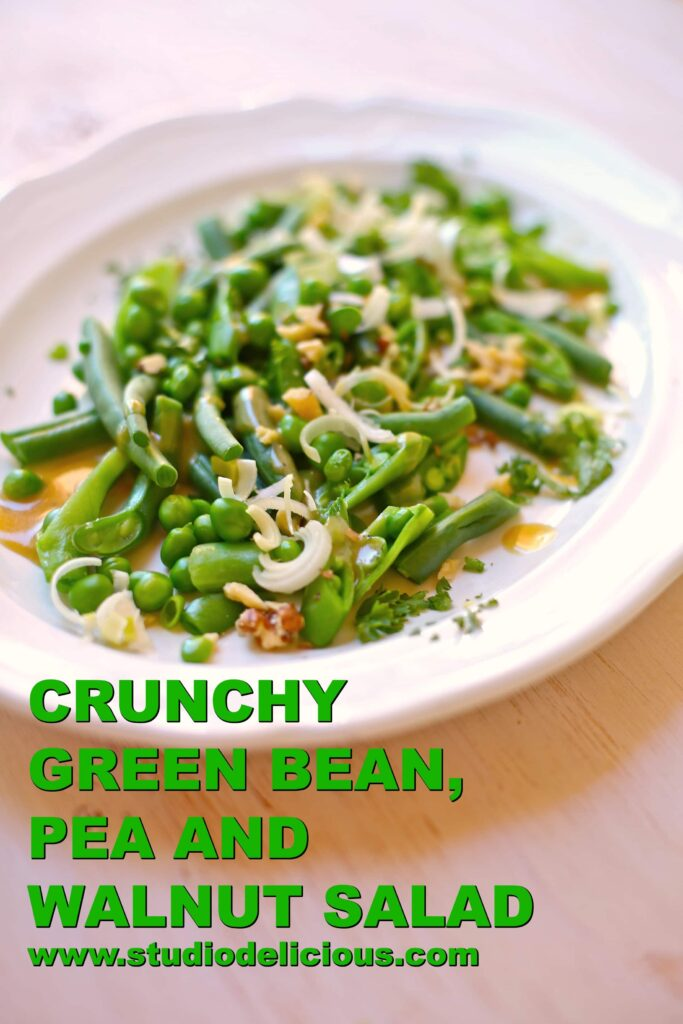 Green Bean, Pea and Walnut Salad on a white platter with green text