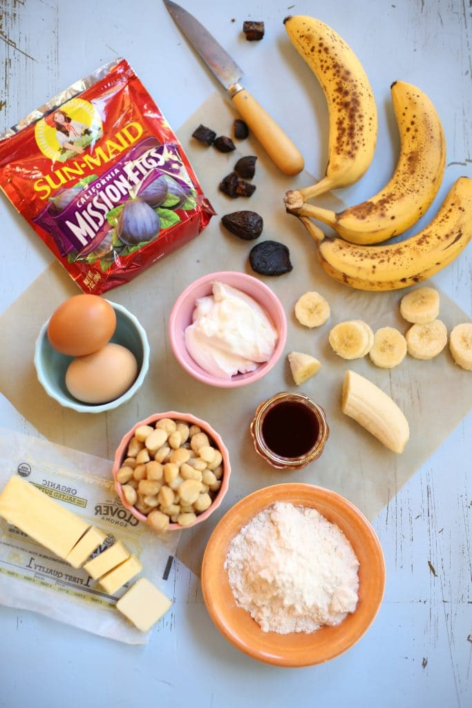 Ingredients for California Fig Banana Bread: ripe bananas, vanilla, yogurt, eggs, butter and sun made figs on a blue wood background