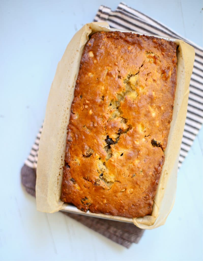 California Fig Banana Bread with a striped towel and blue background