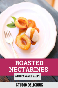 roasted nectarines and ice cream om a white plate