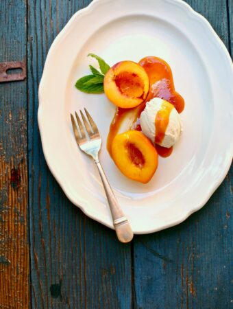 Nectarines on a white plate with a fork