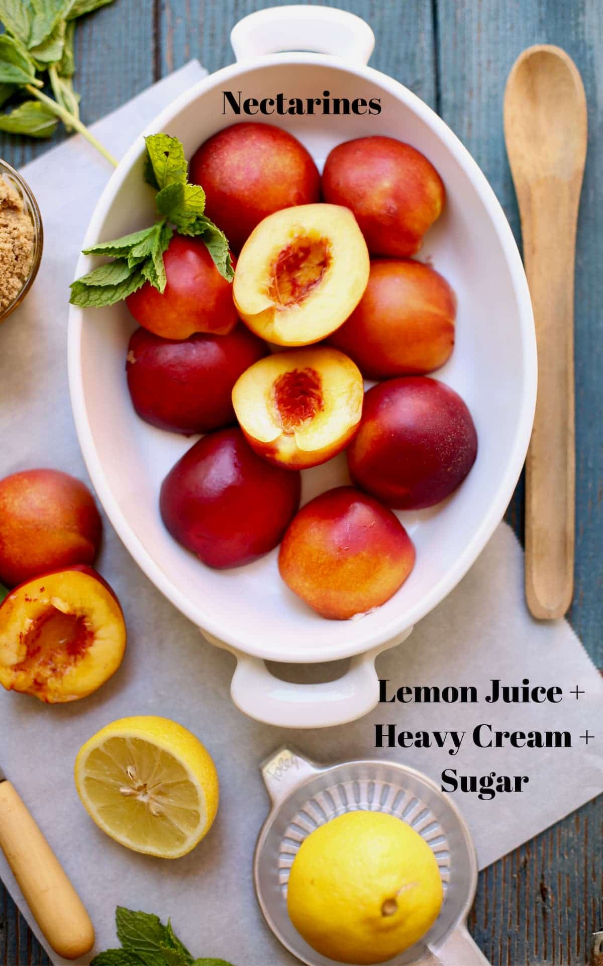 nectarines in a white bowl and wooden spoon next to it.  Lemons cut and mint and other cut nectarines sitting by. Text overlay on top saying what these ingredients are.