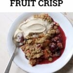 fruit crisp in a white bowl with text