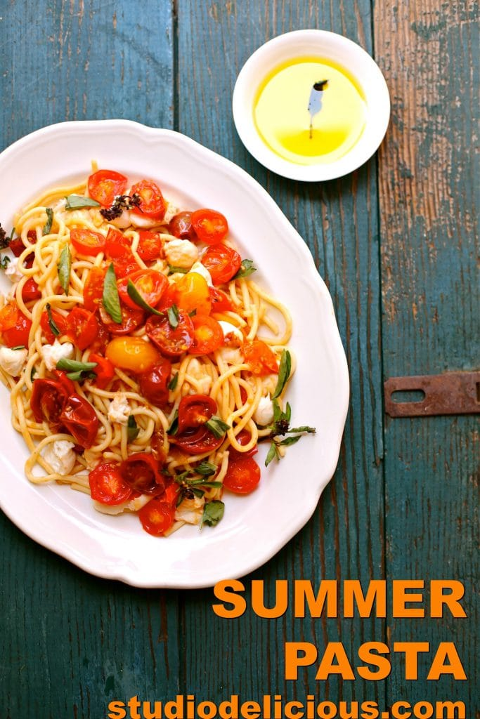 Picture of Summer Pasta with words and white plate and blue wood background