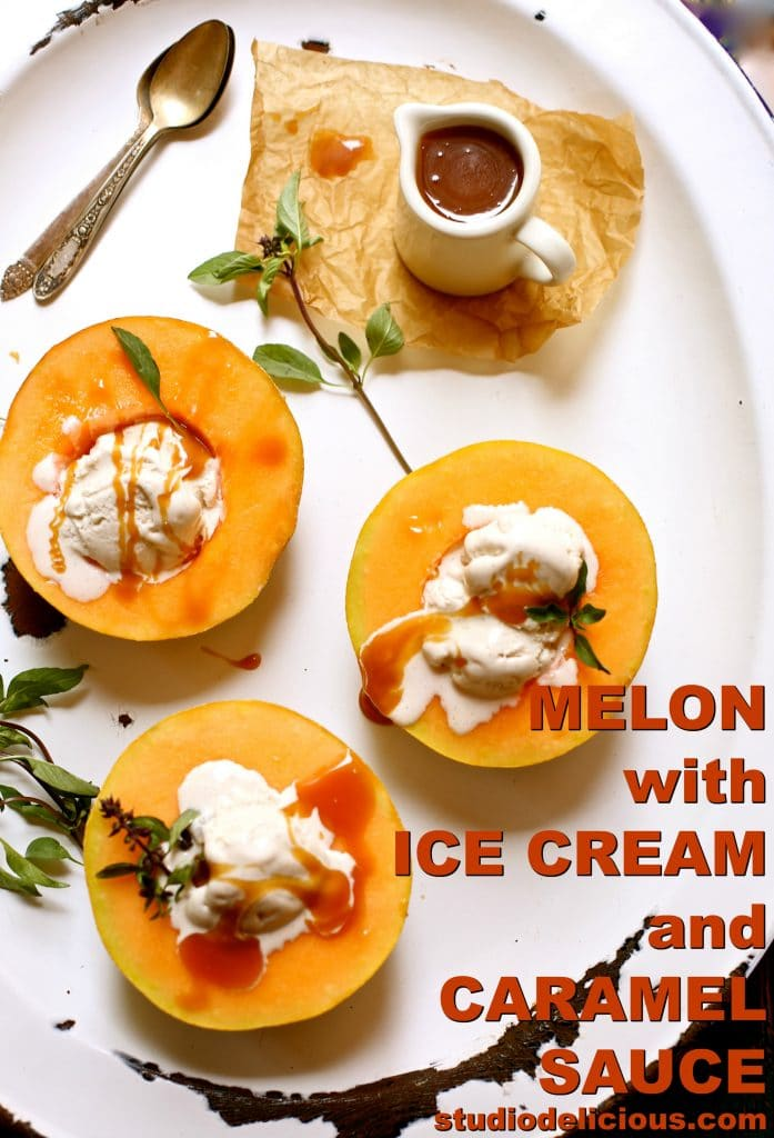Melon with Ice Cream and Caramel Sauce on a white platter with three spoons and basil and caramel sauce