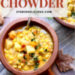 a bowl of corn chowder on a table with leaves and a text box with orange type saying the recipe name.