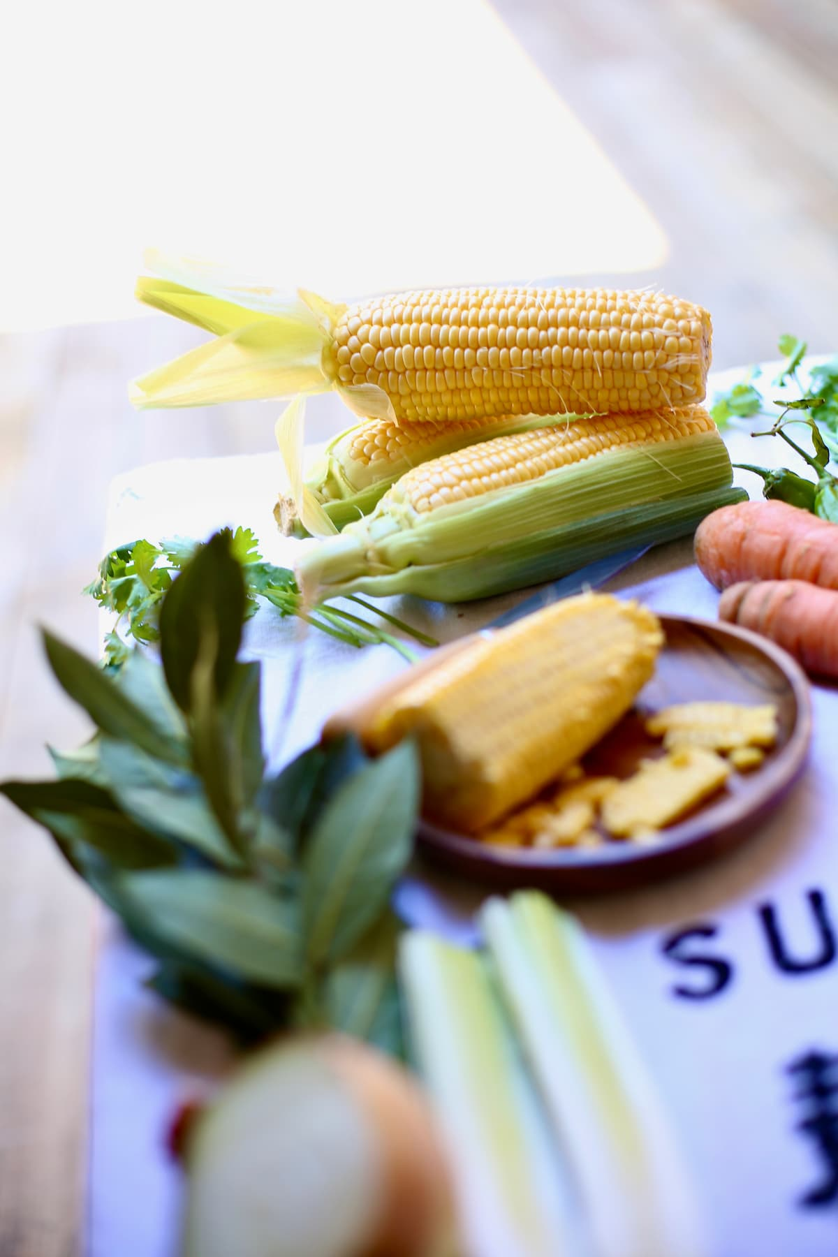 a table with fresh corn thats been cut off the cob.