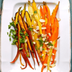 roasted carrots on a white platter
