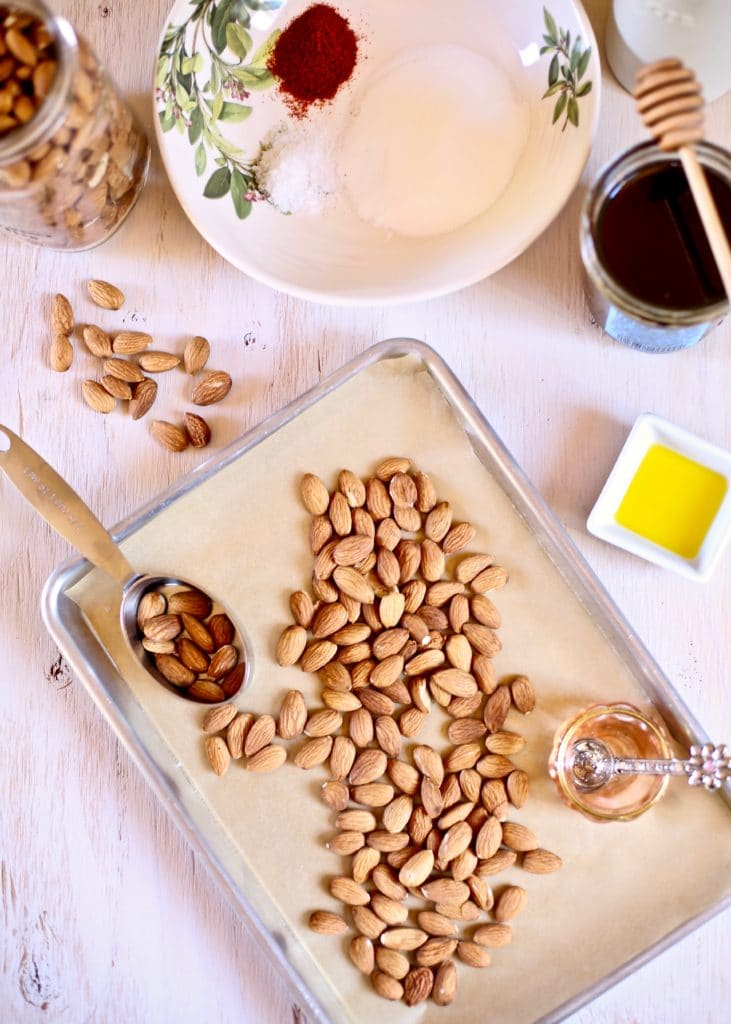 almonds on a try for roasting with olive oil