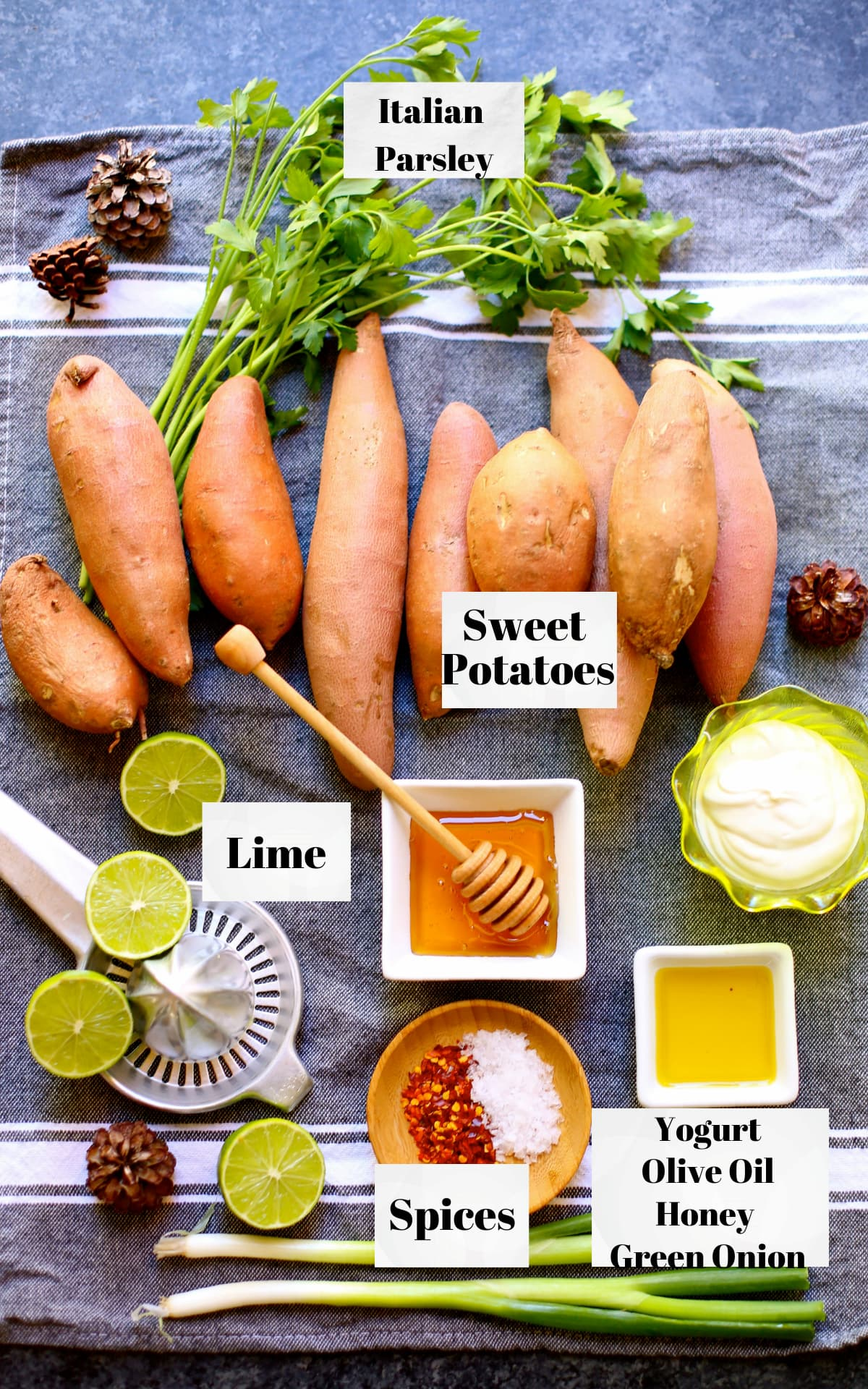 a table of ingredients, sweet potatoes, olive oil, lime, honey, soices and italian parsley.
