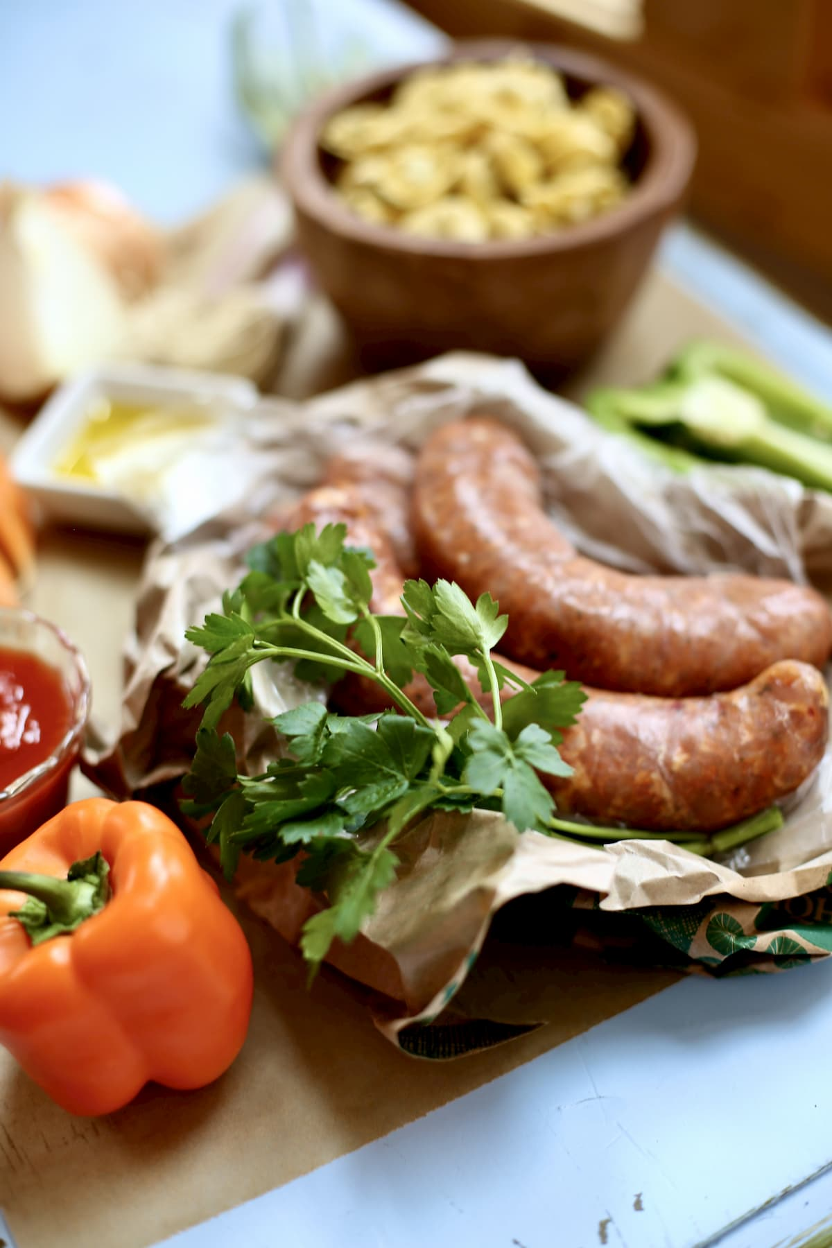 a table of sausage and vegetables to make soup from