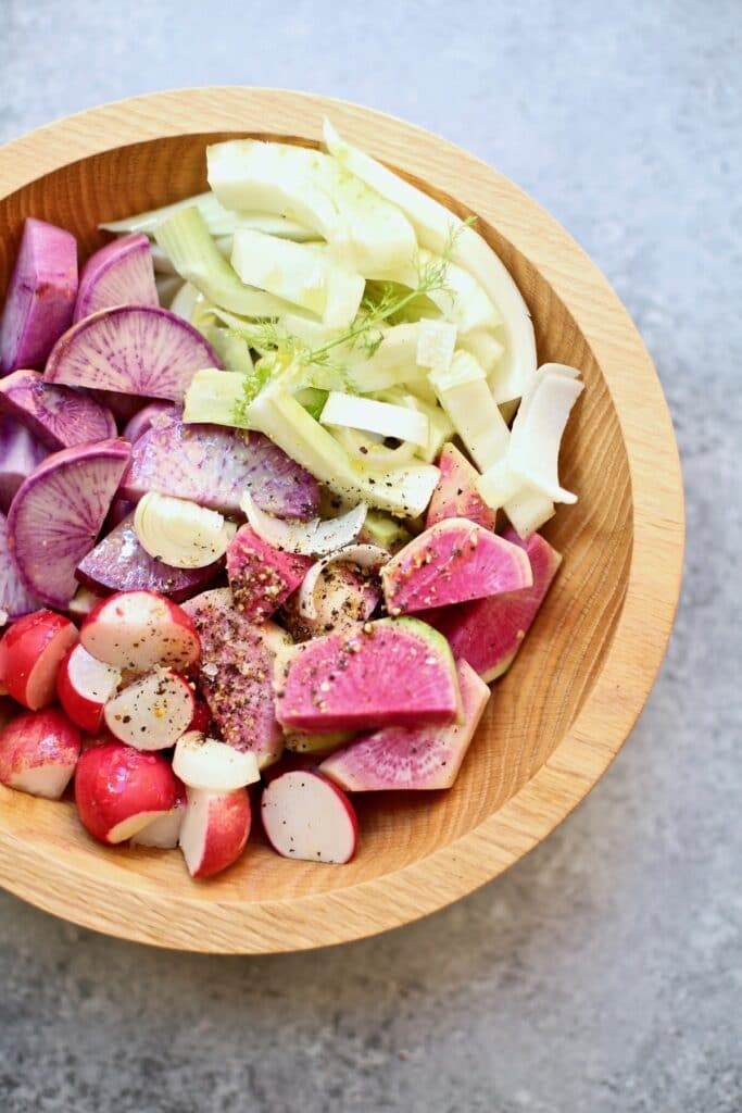 cut vegetables in a wooden bowl