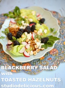 Blackberry Salad with Toasted Hazelnuts text on a blue background and blue platter