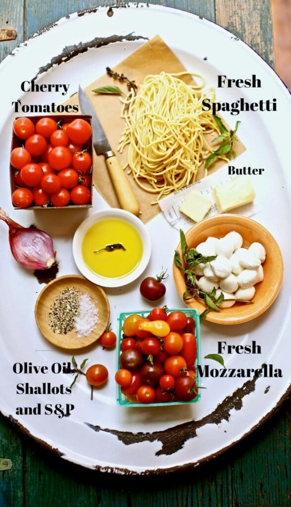 ingredients for pasta on a white platter