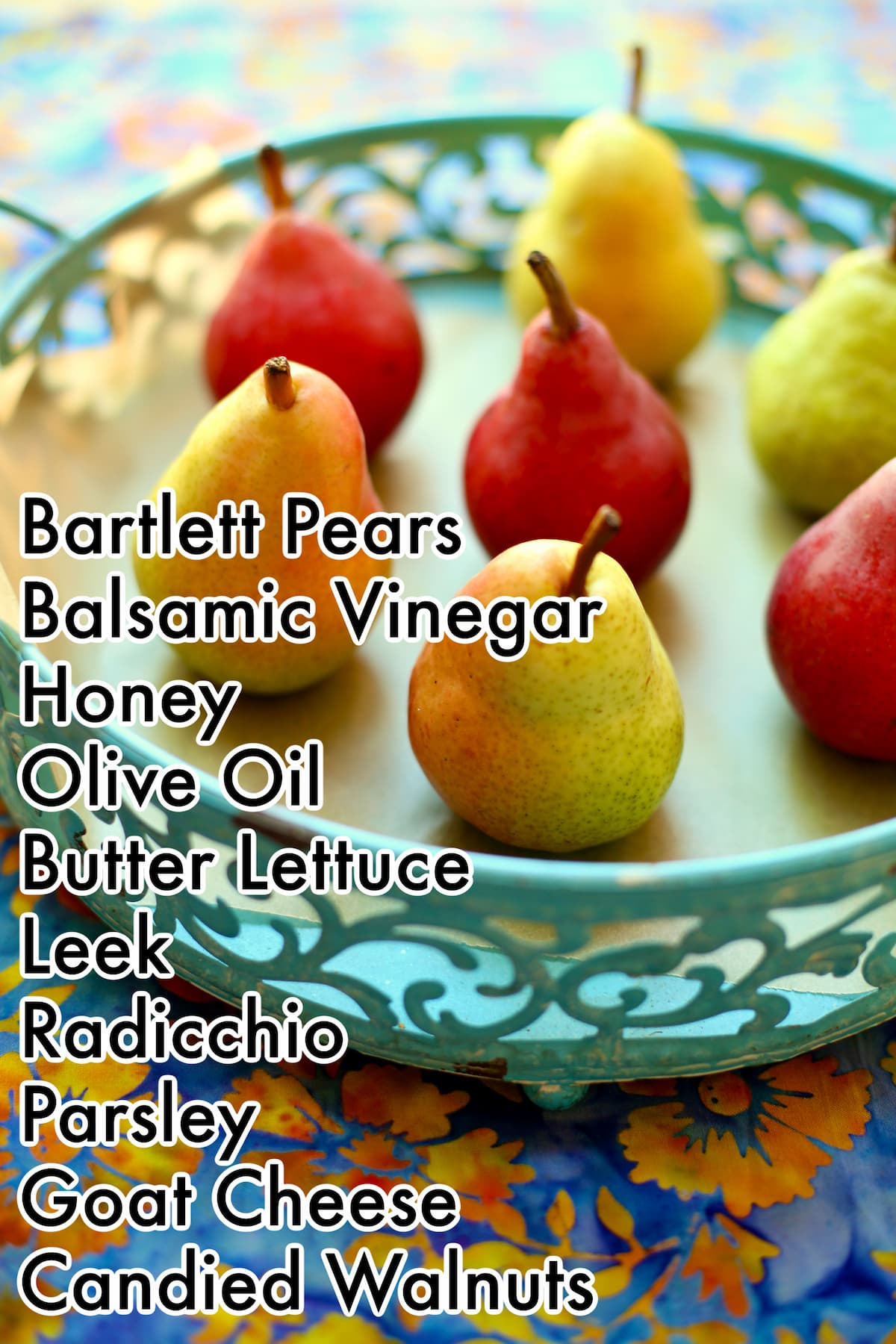 a blue tray of Bartlett Pears on a table with text overlay of ingredient names for a pan roasted pear salad