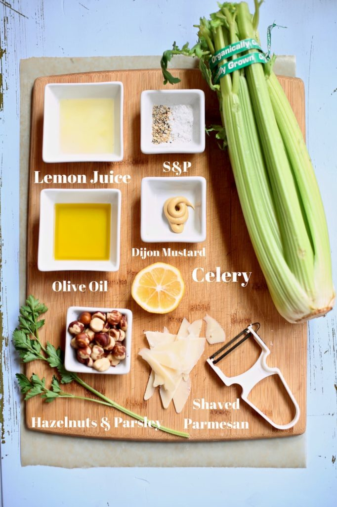 ingredients for salad on a wooden cutting board