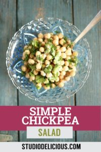 chickpea salad in a blue bowl on a blue table