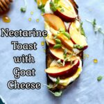 a piece of toast with nectarines and basil and honey on a gray table with text overlay saying the recipe name Nectarine topast with goat cheese