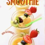 pineapple smoothies on a tray with fruit kabobs