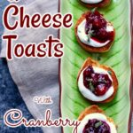 toasts with cheese and cranberry sauce on a green vertical serving plate with text overlay of the recipe name