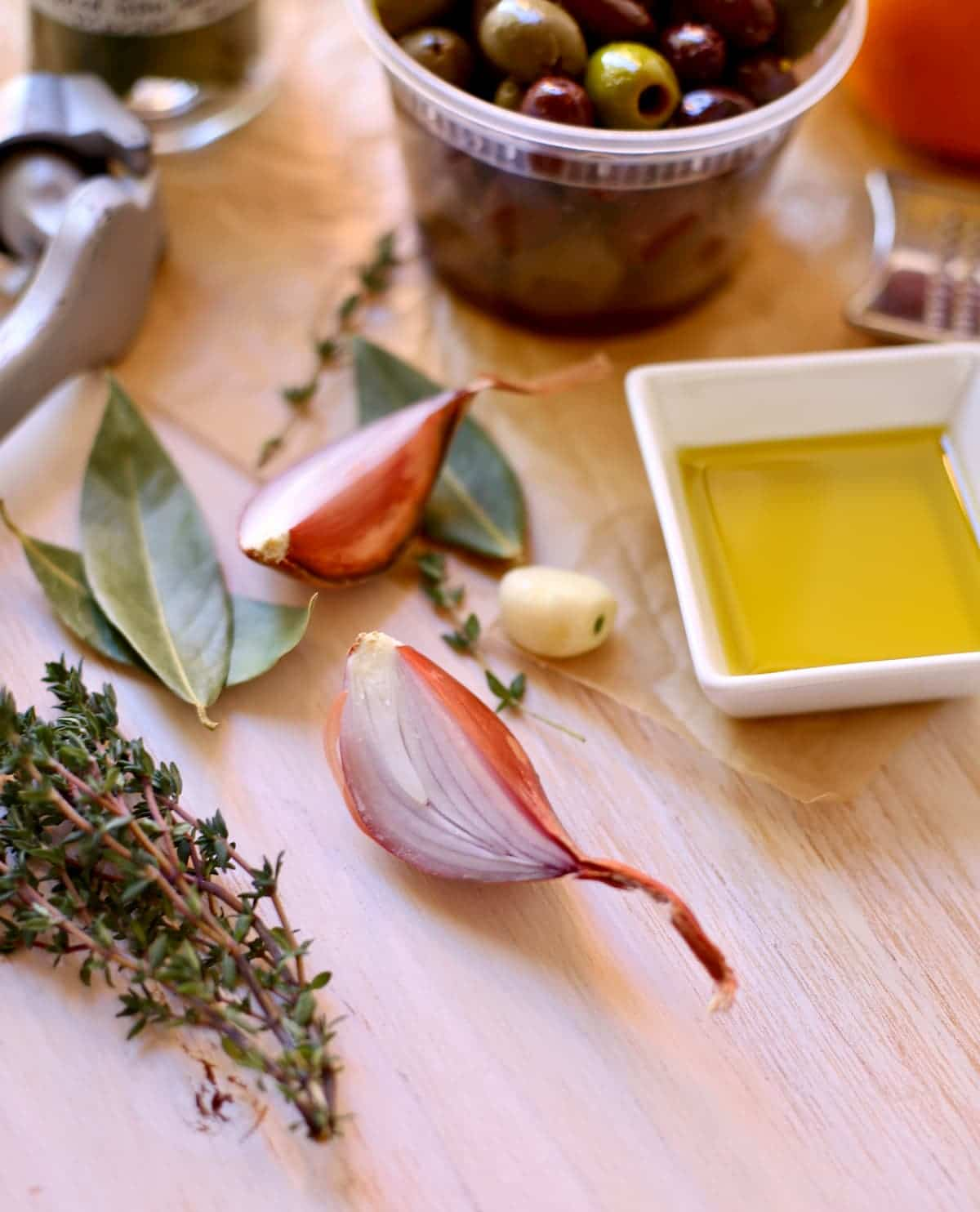 a shallot and other ingredients and herbs on a table