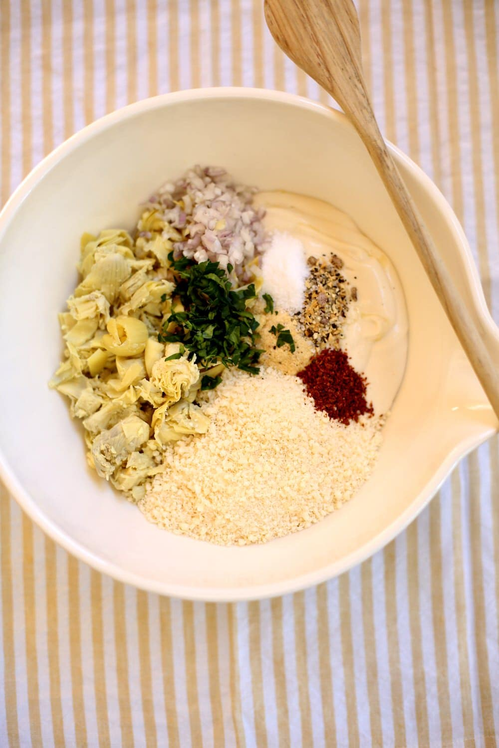 a white bowl full of ingredients for a dip