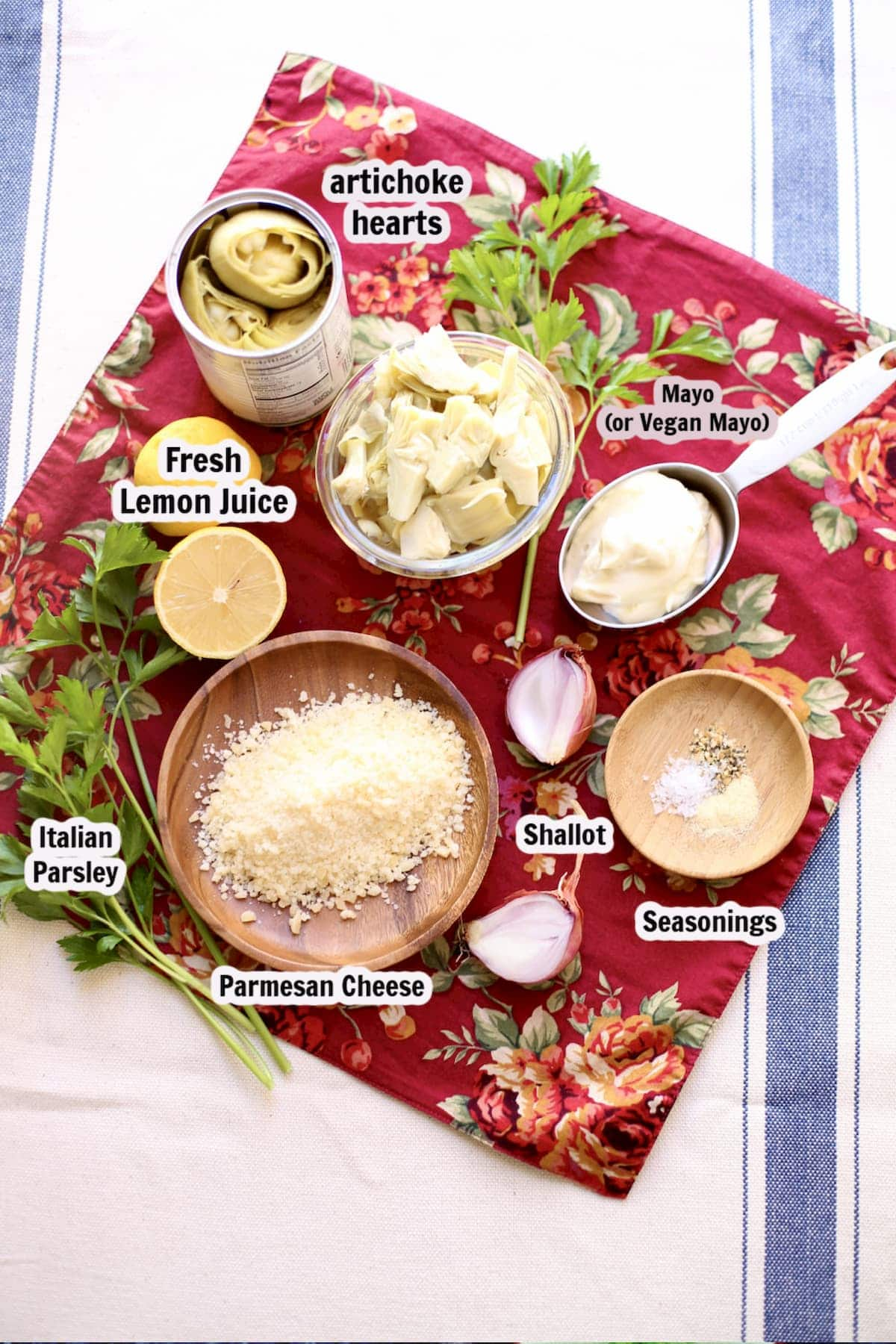a spread of ingredients for artichoke dip with captions of each item, artichoke hearts, parmesan, etc.
