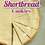 a large round of iced shortbread cookies slices with text overlay telling the recipe title (lemon shrotbread cookies).