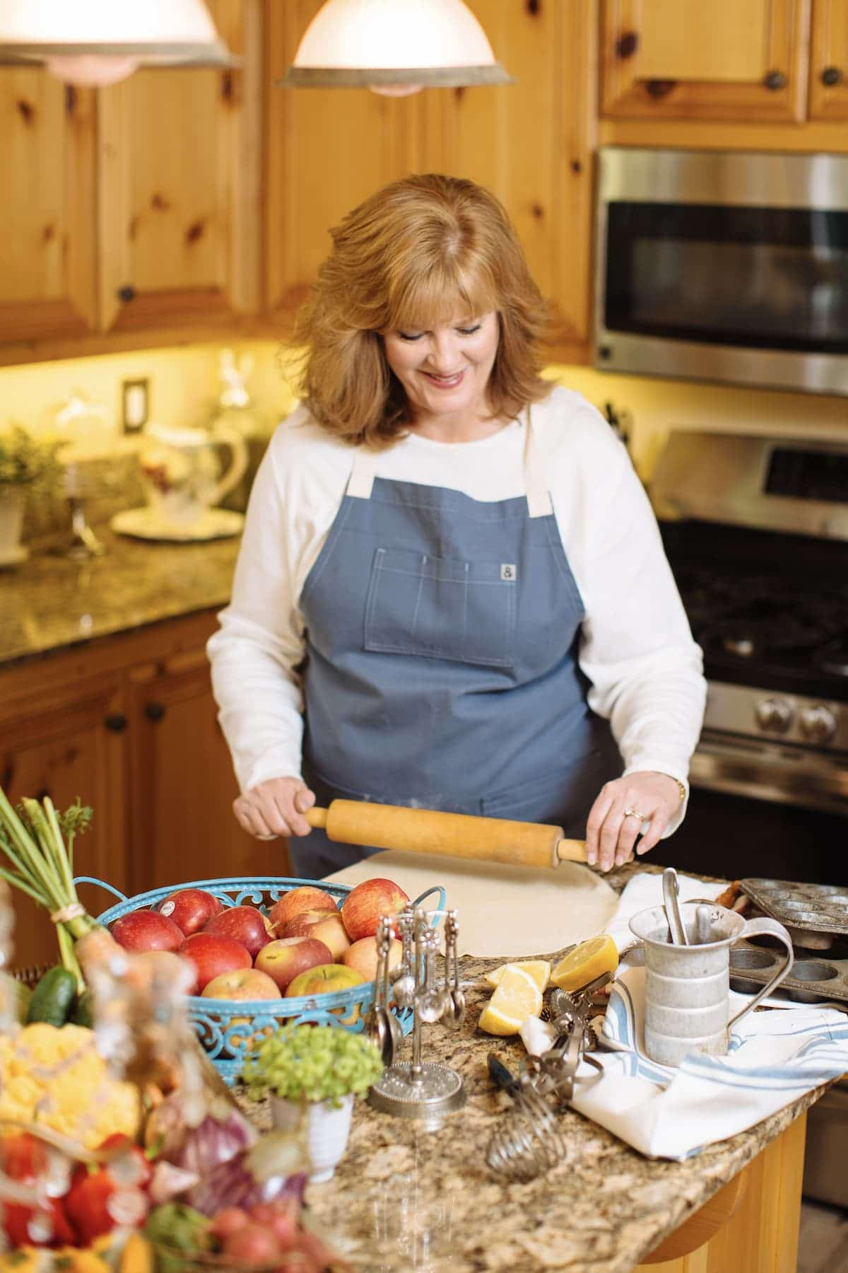 picture of studio delicious author Paige in the kitchen chopping vegetables