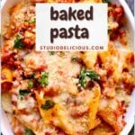 a full frame photo of baked pasta with chicken sausage in a white casserole dish with a small white square and text saying the recipe name.