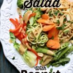 a white plate with carrots, boccoli, red pepper, green peans, bok choy and noodles with a text overlay