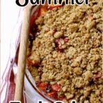 a pan of fruit crisp with a wooden spoon next to it and the name of the recipe in black and white text overlay on top.