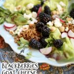 a blue plate with salad of blackberries, goat cheese and grains and radish on a tablecloth with text overlay