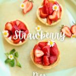 three mini strawberry pies on a serving platter with text over lay saying the recipe name